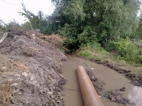 МРСК предлагают расчистить русло этой реки, а не пытаться загнать его в трубу - тут такие разливы бывают...